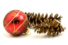 Christmas bauble and pine cones Stock Image