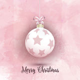 Christmas bauble on a pink watercolor background Royalty Free Stock Photo