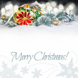 Christmas bauble with poinsettia, branches of Christmas tree on Royalty Free Stock Photos