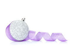 Christmas bauble and purple ribbon Royalty Free Stock Photography