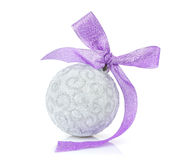 Christmas bauble and purple ribbon Royalty Free Stock Image