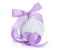 Christmas bauble with purple ribbon Stock Photos