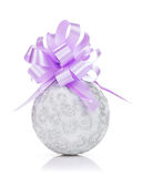 Christmas bauble and purple ribbon Royalty Free Stock Photo