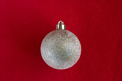 Christmas bauble on red. Christmas bauble on dark red background - see more Stock Images