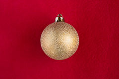 Christmas bauble on red. Christmas bauble on dark red background - see more Royalty Free Stock Image