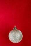 Christmas bauble on red. Christmas bauble on dark red background - see more Royalty Free Stock Images