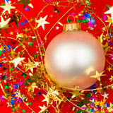 Christmas bauble on red background. Christmas bauble with tinsel on red background Stock Photos