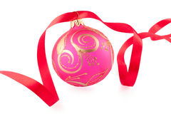 Christmas bauble with a red ribbon. On white background Royalty Free Stock Images
