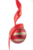 Christmas bauble with red ribbon. Chirstmas bauble with red ribbon writing merry Christmas Royalty Free Stock Photo