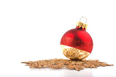 Christmas bauble resting on a golden snowflake Royalty Free Stock Photo