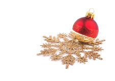 Christmas bauble resting on a golden snowflake Stock Image
