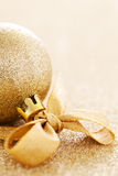 Christmas bauble with ribbon. Golden christmas bauble with ribbon and copy space Royalty Free Stock Photography