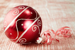 Christmas bauble with ribbon. Royalty Free Stock Photo