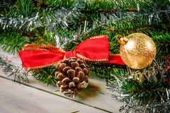 Christmas bauble and a ribbon. Red christmas glass bauble isolated on white Royalty Free Stock Photo