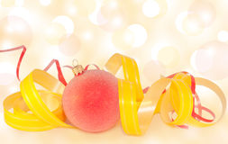 Christmas Bauble and ribbons on blurred background Stock Photography