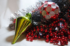 Christmas bauble 8. Silver and red Christmas baubles and lime green bauble sitting in silver tinsel and red beads Royalty Free Stock Photos