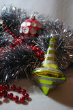 Christmas bauble 9. Silver and red Christmas baubles and lime green bauble sitting in silver tinsel and red beads Royalty Free Stock Photo