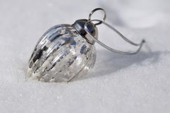 Christmas bauble in snow Stock Photos