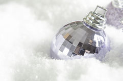 Christmas Bauble in Snow Stock Photography