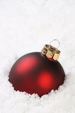 Christmas Bauble in the Snow Royalty Free Stock Photo