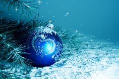 Christmas Bauble in Snow. Near Pine Tree Royalty Free Stock Photography