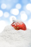 Christmas bauble in snow Royalty Free Stock Images