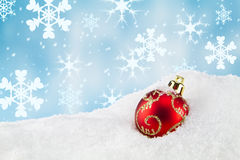 Christmas bauble in the snow Stock Image