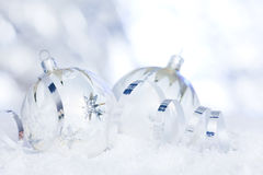 Christmas bauble in snow Royalty Free Stock Image