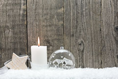 Christmas bauble in snow against Royalty Free Stock Image