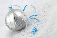 Christmas bauble on snow Royalty Free Stock Images