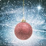 Christmas Bauble with Snow and Star Royalty Free Stock Images