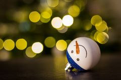 Christmas bauble snowman. And Christmas lights Royalty Free Stock Image