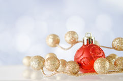 Christmas Bauble with Snowy Bokeh Stock Image
