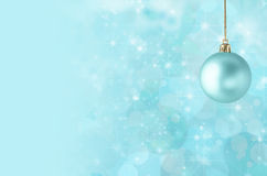 Christmas Bauble on Starry Bokeh Background Royalty Free Stock Photos