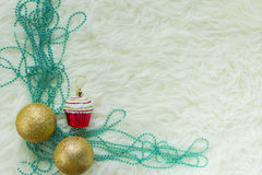 Christmas bauble on white fur and colorful lights. Texture white fur happy New year 2017, merry Christmas Royalty Free Stock Image