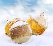 Christmas bauble on white snow background Stock Image