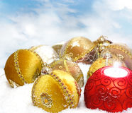 Christmas bauble on white snow background Stock Photo
