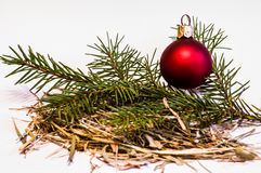 Christmas Bauble with young Spruce tree branch. Located in the hay Stock Photos
