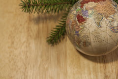 Christmas Bauble with young Spruce tree branch. On wood background Stock Photography