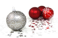 Christmas Baubles. Four red and silver christmas baubles with silver stars on white background Stock Images