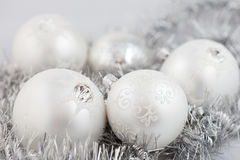Christmas baubles. Collection of christmas baubles on silver background Royalty Free Stock Photo