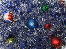 Christmas Baubles. On the silver tinsel Stock Images