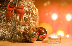 Christmas baubles. Baubles, candle lights and christmas tree Stock Photography