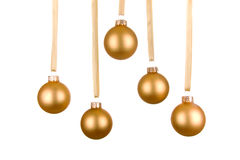 Christmas Baubles. Gold Christmas ball hanging from gold ribbon Stock Image