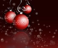 Christmas baubles. Christmas baubles on dark snowflake background Royalty Free Stock Photo