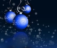 Christmas baubles. Christmas baubles on dark snowflake background Stock Photo