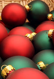Christmas baubles. Pile of red and green Christmas baubles or balls in wicker basket stock image