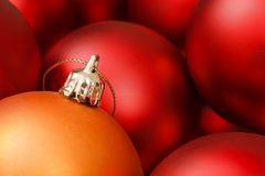Christmas baubles. Colorful christmas baubles in red and gold Royalty Free Stock Images