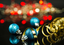 Christmas baubles. Christmas blue baubles with blurry lights background Royalty Free Stock Photo