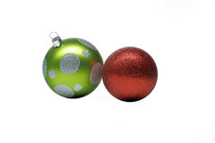 Christmas baubles. Two christmas baubles,one green and one red in a white background stock photos